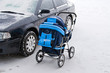 car and baby's pram on parking - danger for child
