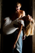 Male vampire is carrying a blonde dead woman