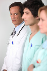 Doctor and nurses in a line