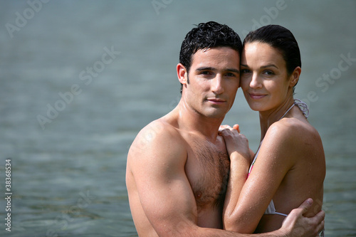 Couple embracing while bathing in the sea