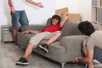 Three men arranging furniture