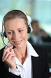 Woman smiling holding headset