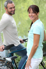 couple biking in the nature
