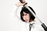 lolita fashion asian woman with samurai sword