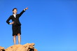 Business concept - businesswoman pointing at future ahead