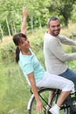 a couple doing bike in the country