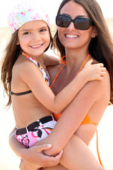 Mother and daughter at the beach together