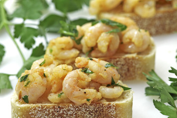 Garlic shrimp tapas on sourdough bread