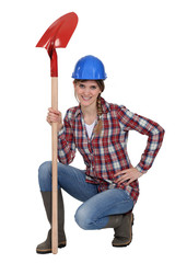 A handywoman with a shovel.
