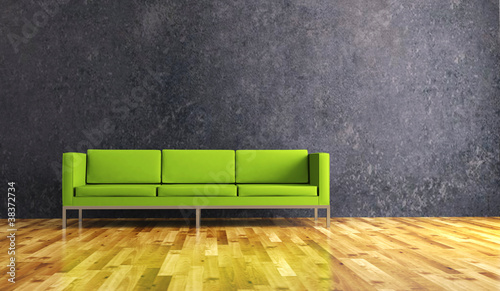 Wohndesign - grünes Sofa vor Betonwand