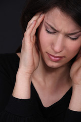 Woman suffering from a throbbing headache