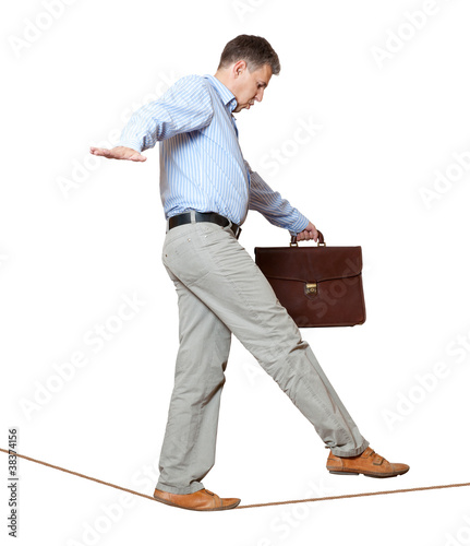 Businessman rope-walker. Isolated