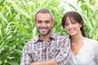 Couple in front of green plants