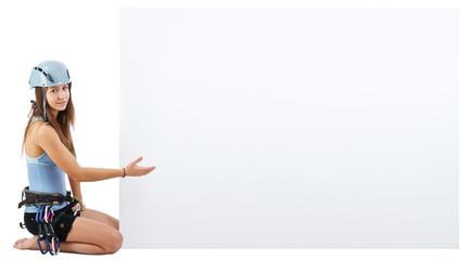 climbing woman holding a banner