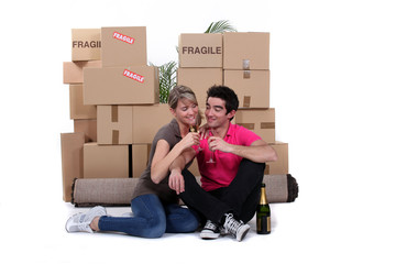 Couple celebrating house move