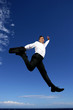 Businessman leaping through the air