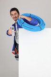 Cheerful workman holding phone, studio shot