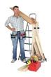 craftsman holding a wooden floor board