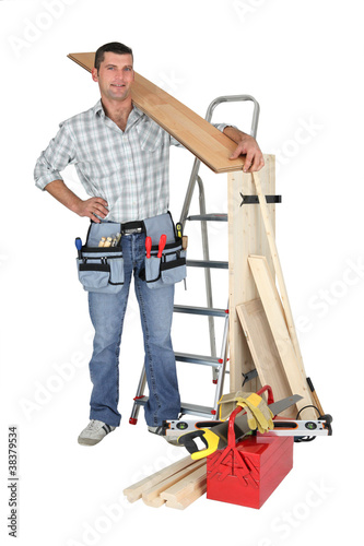craftsman holding a wooden floor board