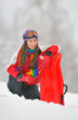 Young Beautiful Woman play in winter time