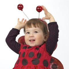 The little girl in a ladybird suit