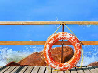 sea and pier with life buoy
