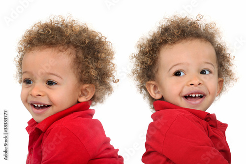 Adorable-looking twins with curly hair