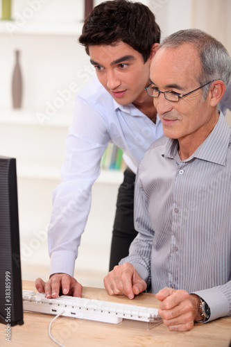 Elderly man learning computer skills
