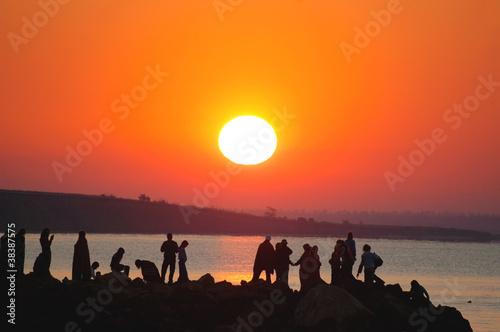 Sunrise and people