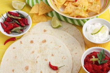 Tortillas with nachos and dips