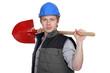 Tradesman holding a spade