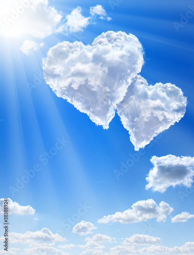 Fridge magnet Hearts in clouds against a blue clean sky