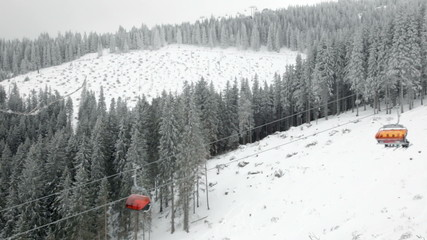 Chairlift in snowy winter mountains