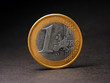 One euro coin on black background