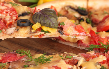 delicious pizza and vegetables closeup