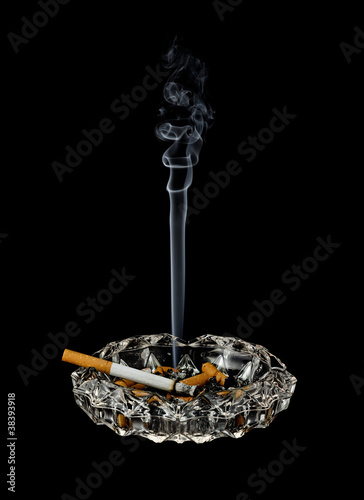 Smoking cigarette in ashtray