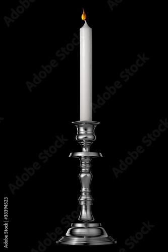 Silver candlestick with candle isolated on black