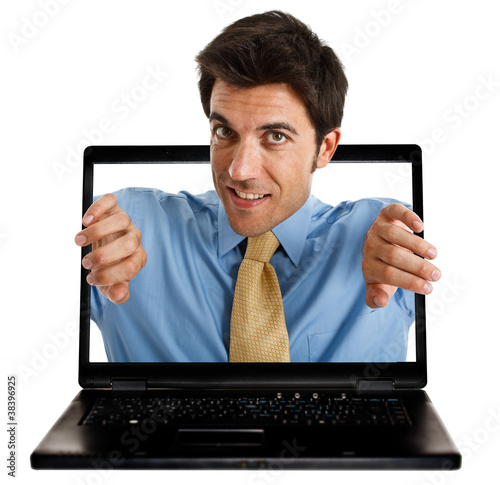 Man coming out from behind the laptop