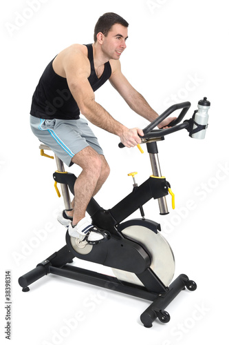 one man doing indoor biking exercise
