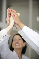 Business team celebrating success with high five