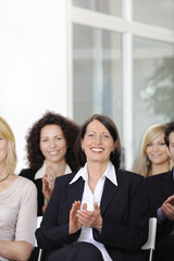 Business team applauding after a conference