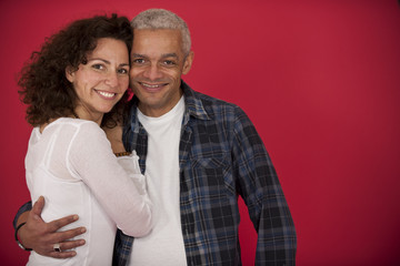portrait of a mid adult couple hugging