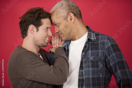 Gay couple on red background