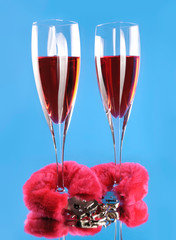Two wine glasses and love cuffs