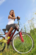 beauty girl on bike in summer day