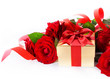 art Valentine Day golden gift box and red roses on a white backg