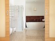 En suite bathroom with freestanding bath