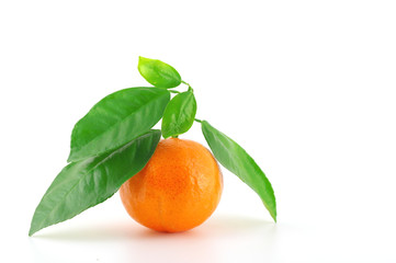Ripe fresh mandarine with green leaves