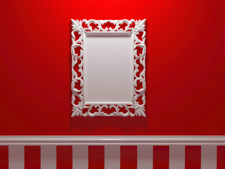 Antique white ornamented picture frame on the red wall