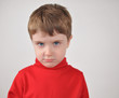 Young Boy Upset with Red Shirt